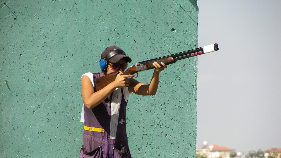 man taking a shot using his rifle